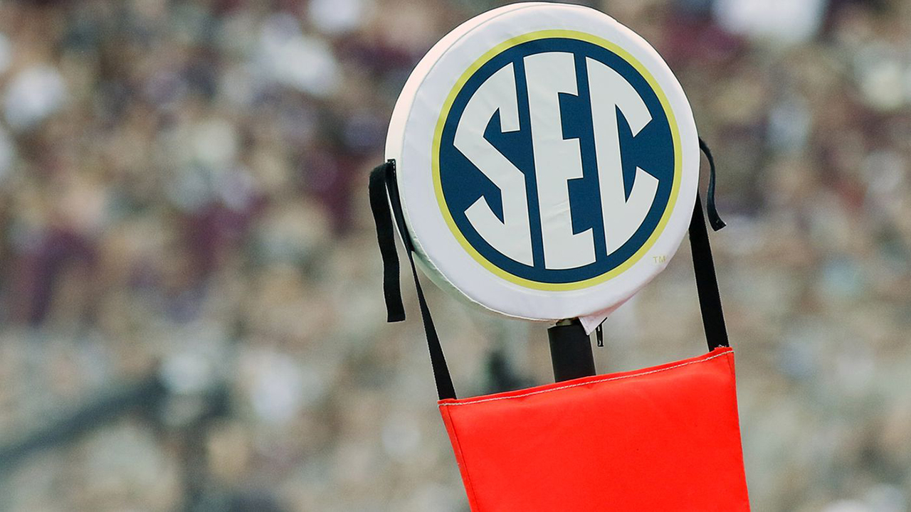 The SEC logo is pictured on a football down marker.