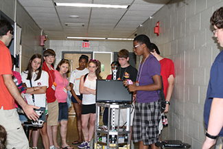 Students learning about Tourbot