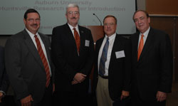 John Mason, vice president for research, Rodney Robertson, director of Auburn's Huntsville Research Center, and Jay Gogue, president of Auburn University