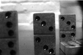 Baseline image of set of dominoes placed at varying distances from camera