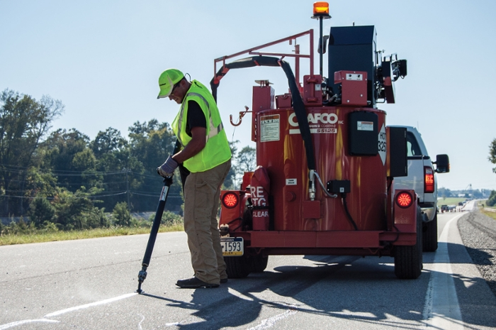 Sealant is precisely applied to cracks in a U.S. Route 280 pavement preservation test section.